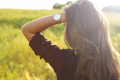 young woman with wristwatch