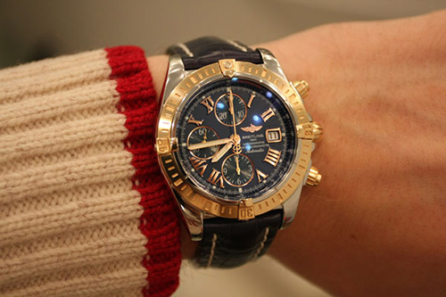 A man wearing Breitling watch