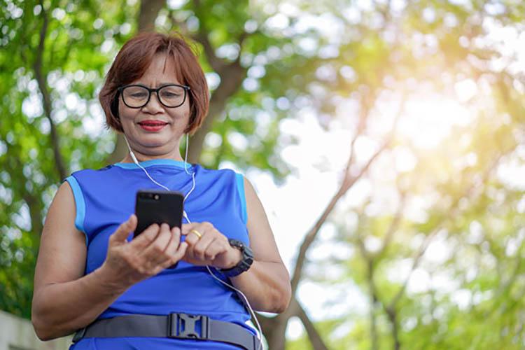 senior enjoying smartwatch and smartphone