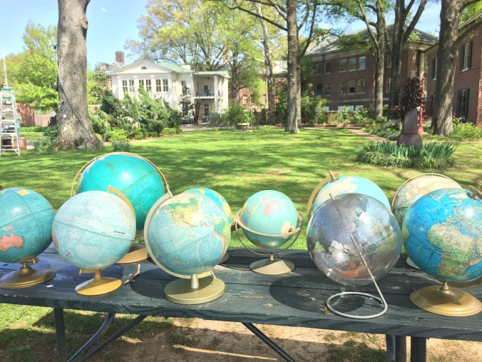 We used vintage, repurposed props where could. These globes were rented from PropCellar Memphis.