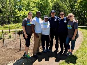 Volunteers after preparing Miss Mary's Woodlawn community garden site, including WeTHRIVE! team members