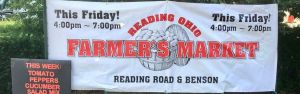 banner announcing reading farmer's market days and times