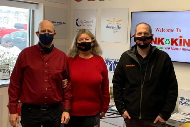 3 adults wearing masks