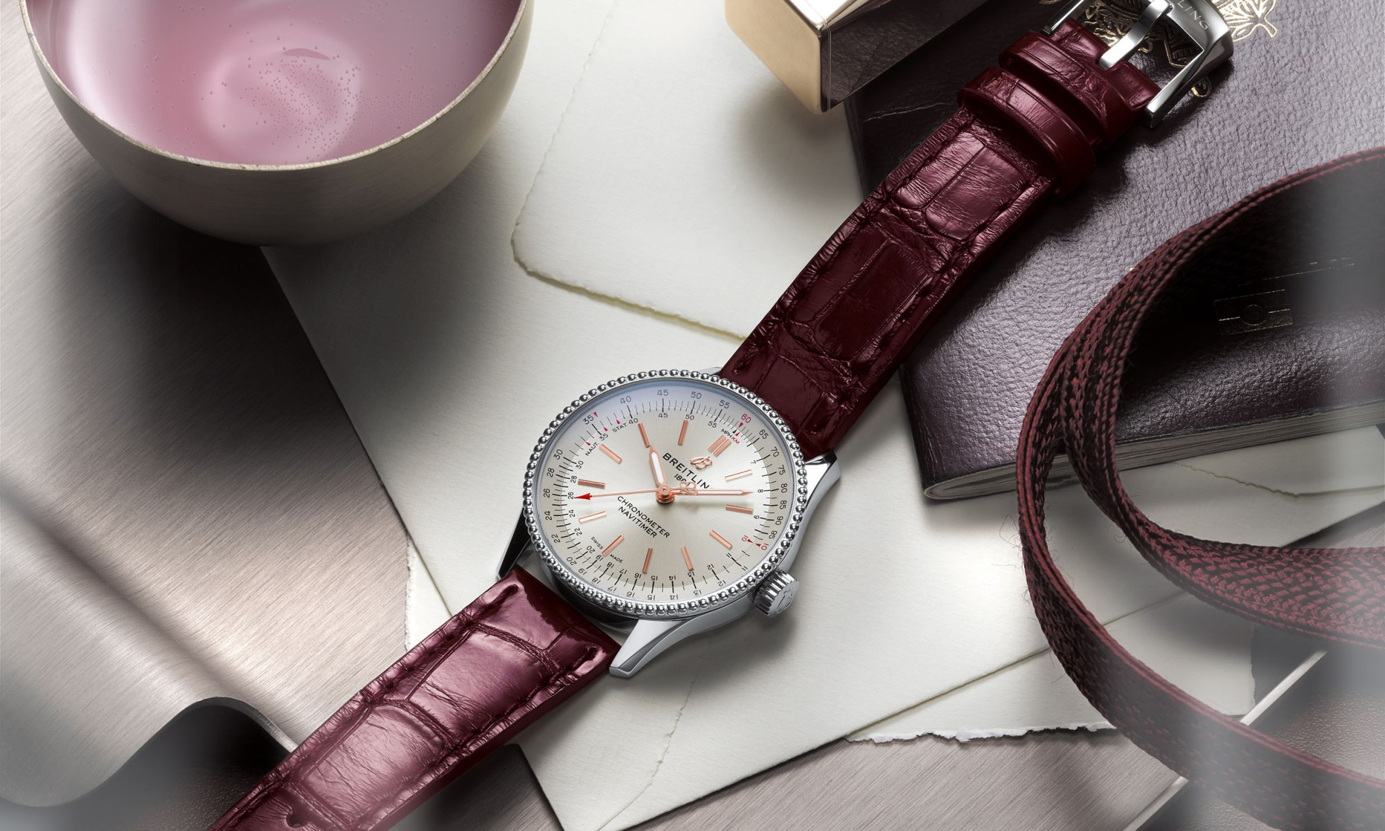 06 Navitimer Automatic 35 With A Silver Dial And A Burgundy Alligator Leather Strap 1