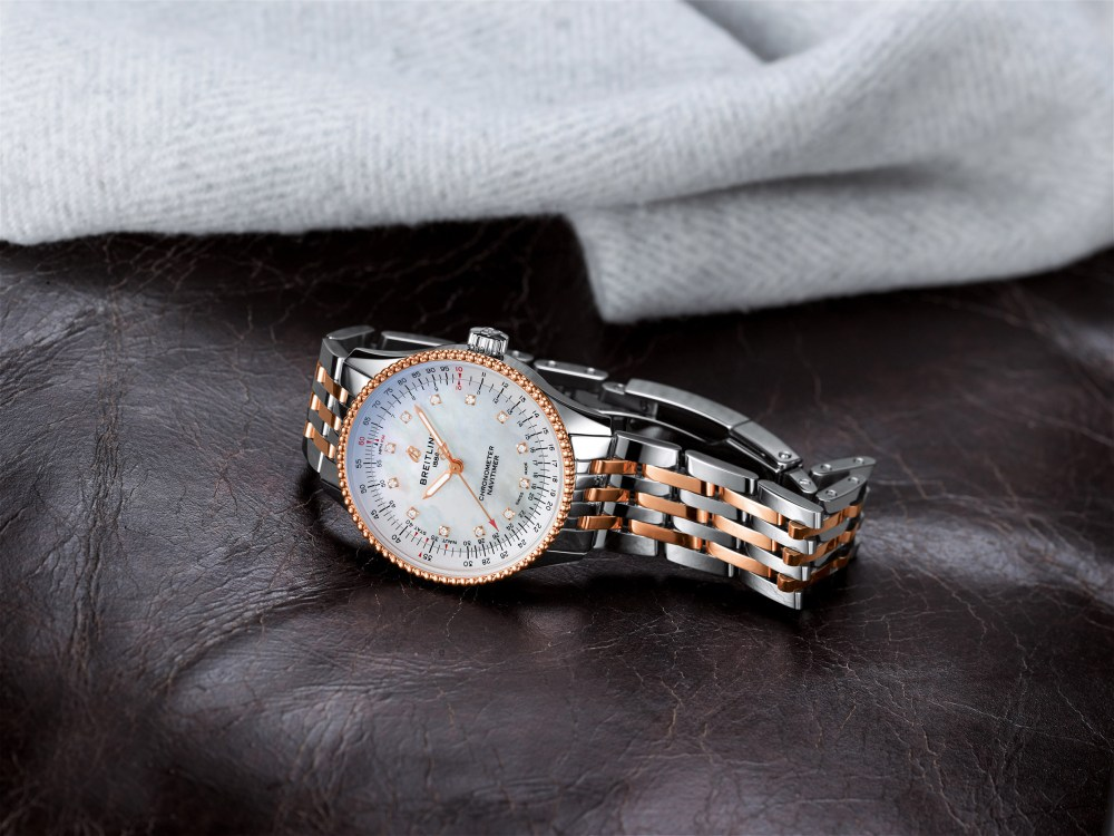 11 Two Tone Navitimer Automatic 35 With A White Mother Of Pearl Dial With Diamond Hour Markers And A Luxurious 18 K Red Gold Bezel 1 1024x768
