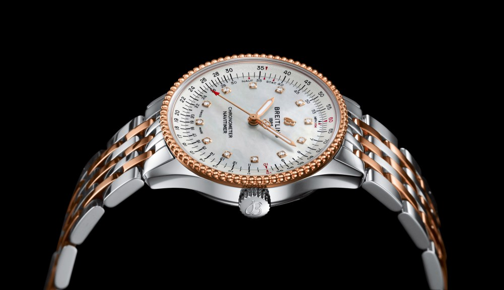 12 Two Tone Navitimer Automatic 35 With A White Mother Of Pearl Dial With Diamond Hour Markers And A Luxurious 18 K Red Gold Bezel 1 1024x590