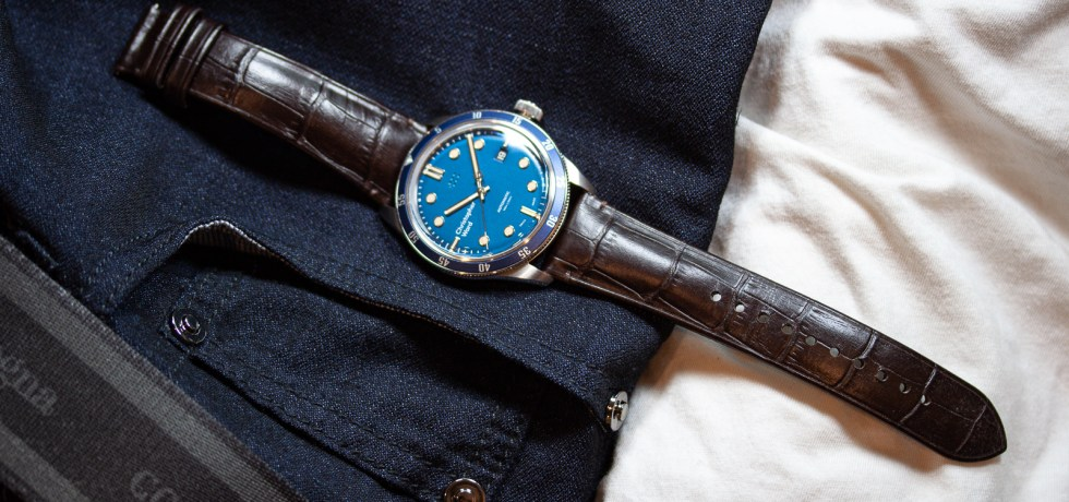 Christopher Ward C65 Trident Automatic Watch paired with white shirt and blue jeans