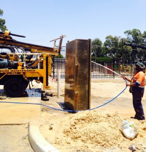 Cleaning out the mud tank after drilling a commercial bore in Forrestfield.