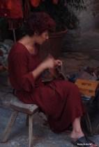 Bevagna Medieval Festival Woman mending leather