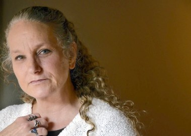 """Annapolis, MD -- 1/3/12 -- md-ar-book-p02-davis -- Jennifer Wheatley-Wolf, 53, of Arlington, VA, has written about her rape case with the chief investigator, David H. Cordle, Sr. The book, """"One Voice Raised: A Triumph Over Rape,"""" describes her experience and the 20 year search to find the rapist who attacked her in 1988. Amy Davis [Sun Photographer] #0343"""