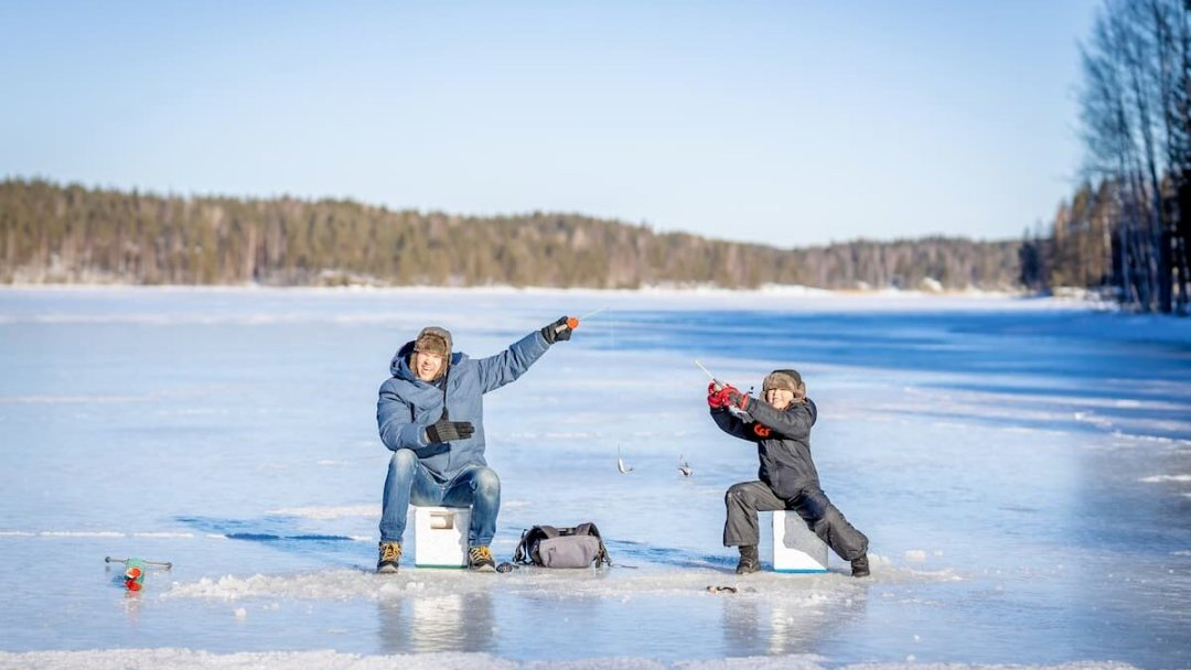 A father and son ice fishing near Westport, Ontario.