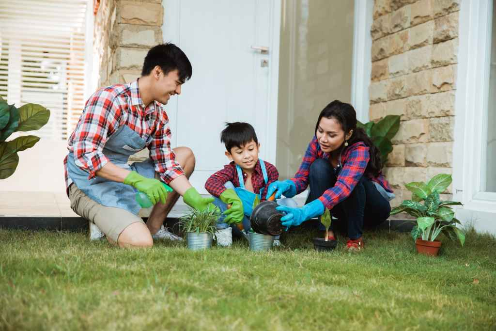 A young family gardening in their backyard at Watercolour Westport.