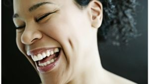 black woman laughing
