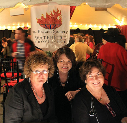 WaterFire Volunteers greet arrivals at the Brazier Society Tent