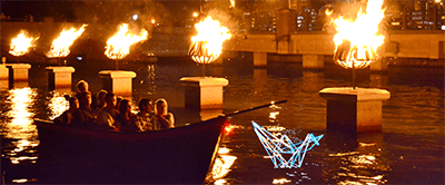 A romantic boat ride through Waterfire, photo by John Simonetti.