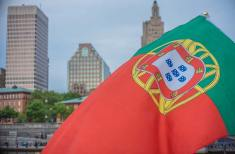 The Portuguese flag flying over the Providence skyline, photograph by Jen Bonin.