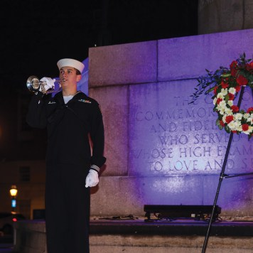 Bugler at The Great War Memorial during a WaterFire Salute to Veterans Event. Photograph by Matthew Huang.