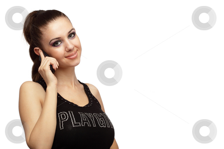 Attractive girl talking on a phone stock photo