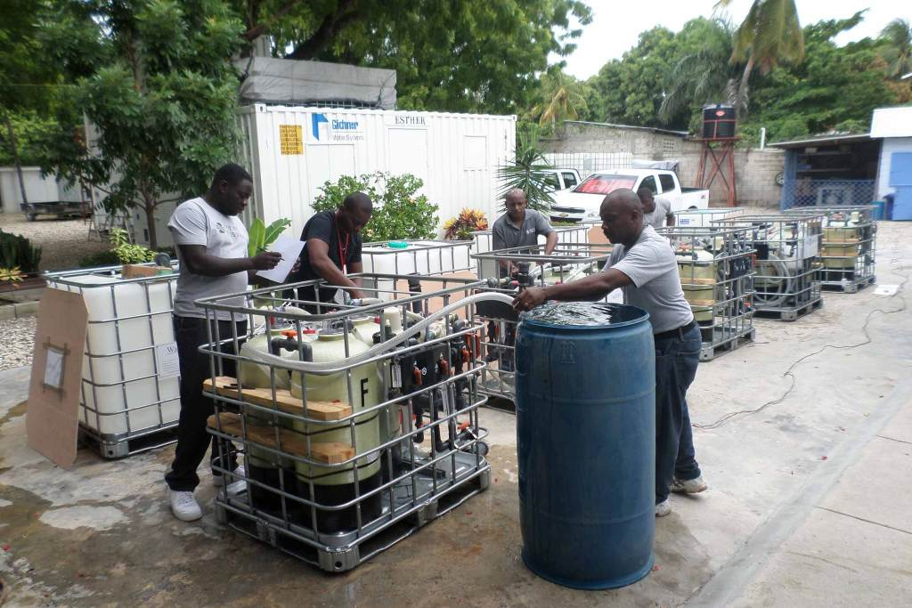 Water Mission Haiti staff prep treatment systems before moving into the field.