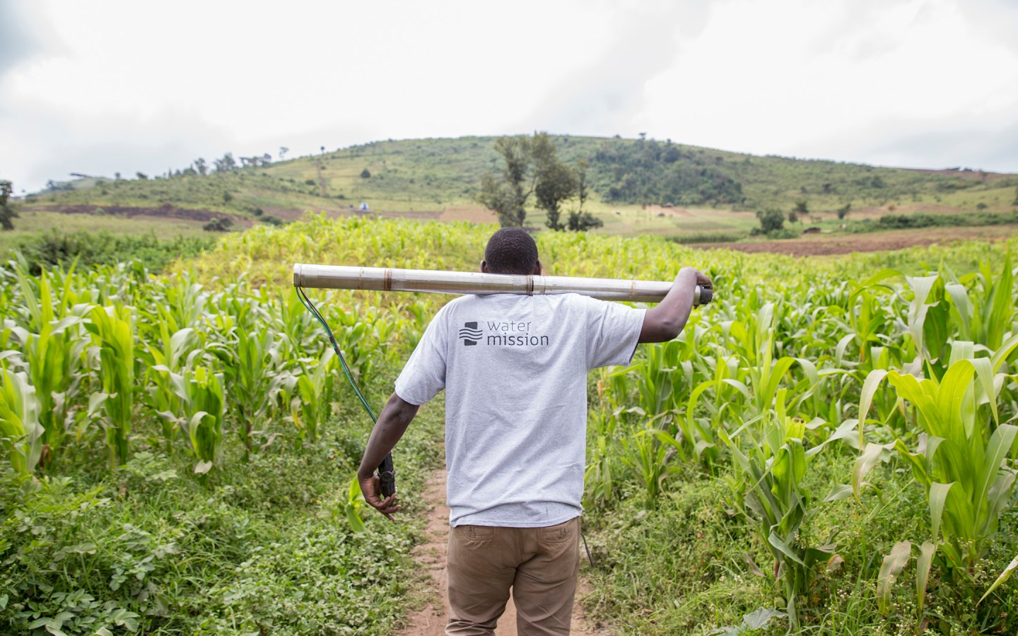 Water Mission technician carries a submersible water pump to a site in Enariboo, Kenya.