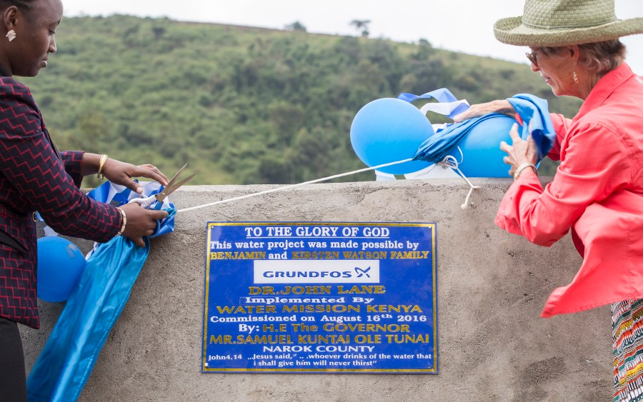 Water Mission Founder Molly Greene helps celebrate the new safe water project in Enariboo, Kenya.