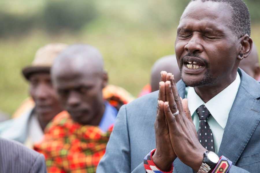 A leader in Enariboo, Kenya, prays for a solution to find safe water.