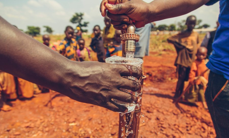 Safe water flowing from a tap in Nyarugusu Refugee Camp, Tanzania.