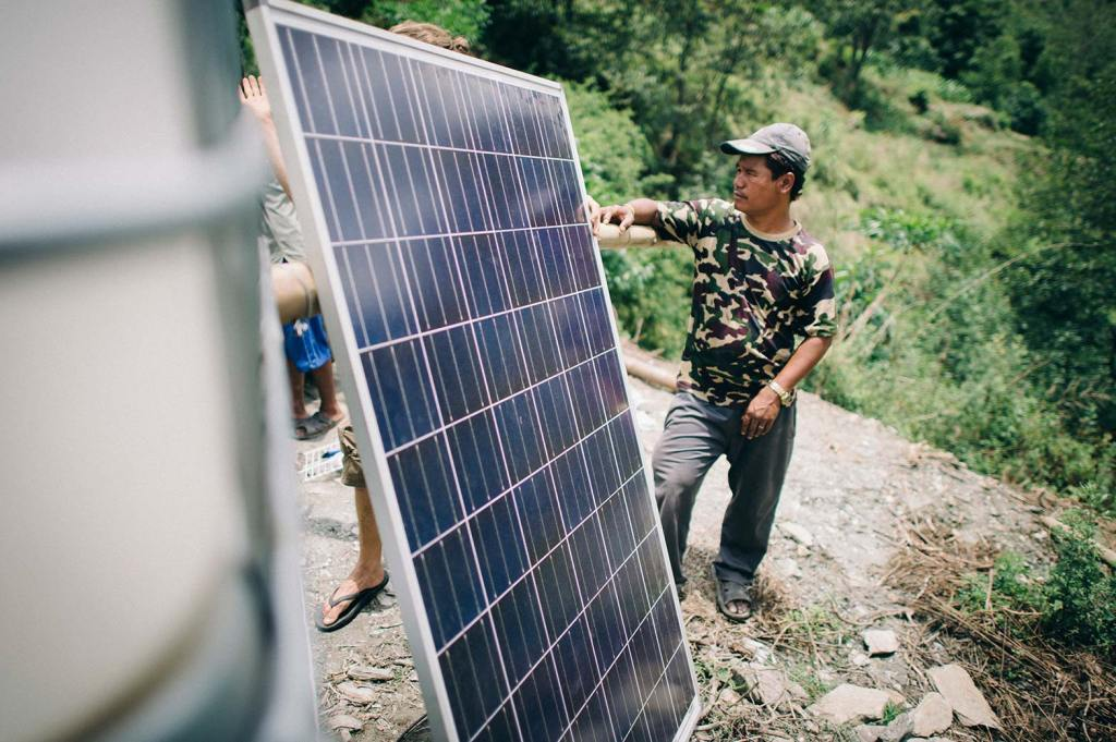 Solar panels are installed at a disaster response project in Nepal.