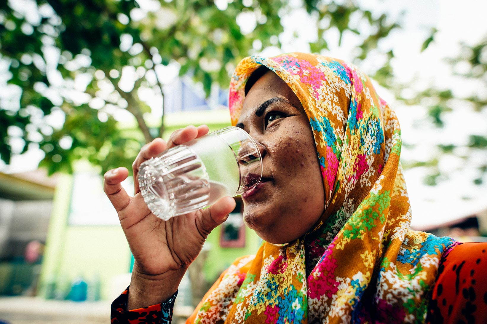 Hayani drinks safe water at her home in Indonesia.