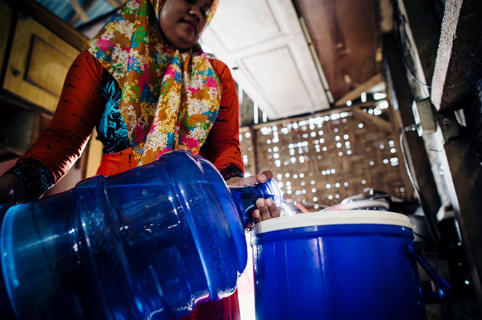 A mother collects safe water for her family in Indonesia.