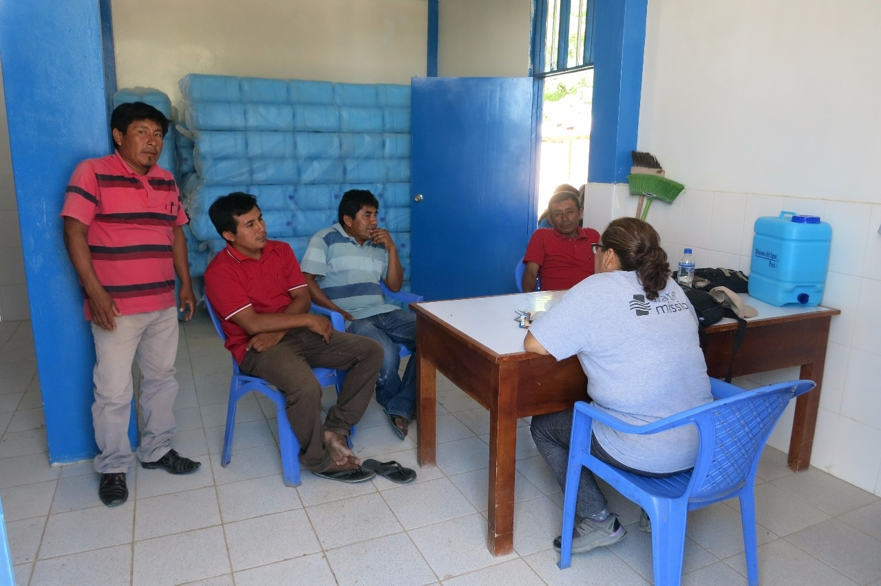 Water Mission staff meet with community members in Peru.