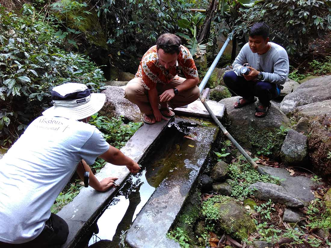 Water Mission staff assess the water situation in Huta Ginjang.