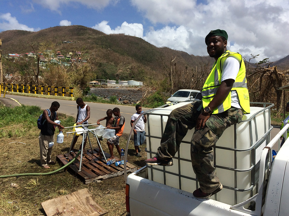 The safe water treatment system operator observes as safe water is distributed.