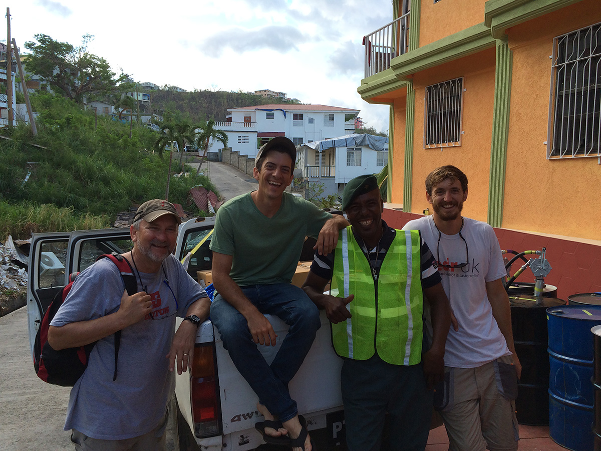 Water Mission engineer, Nick Mason, poses for a photo with some of the disaster response team.