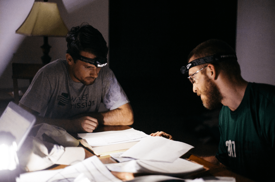 Sean McSwain (Project Manager) and Michael Steele (Field Engineer) work late at night without power.