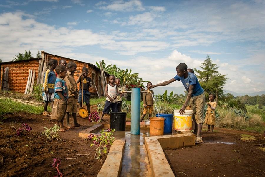 Children draw water in Tanzania.