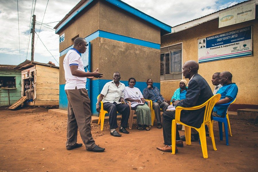 A group of active community members in Uganda discusses their water system.