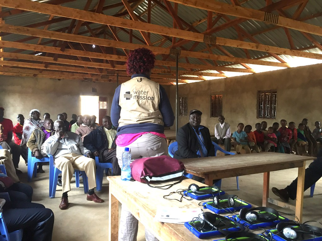 Participants in Kenya learn about the Restore Survey.