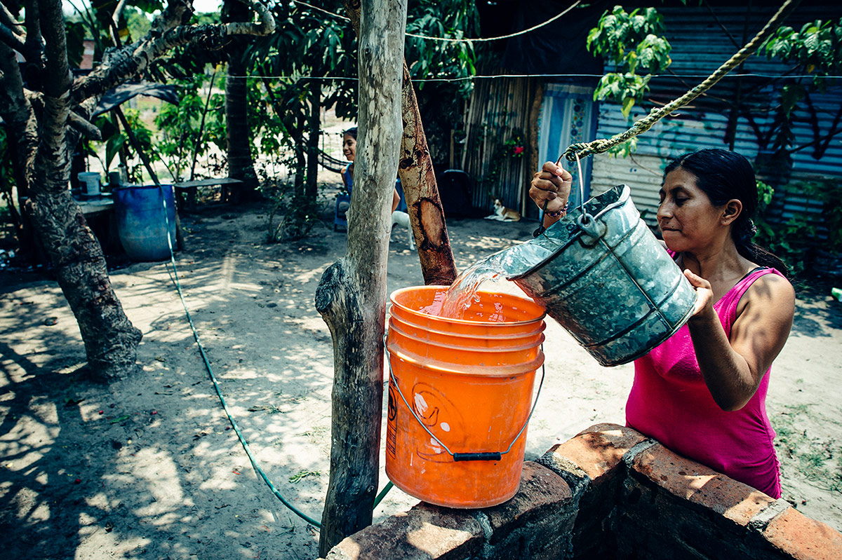 Hortencia draws water for her family