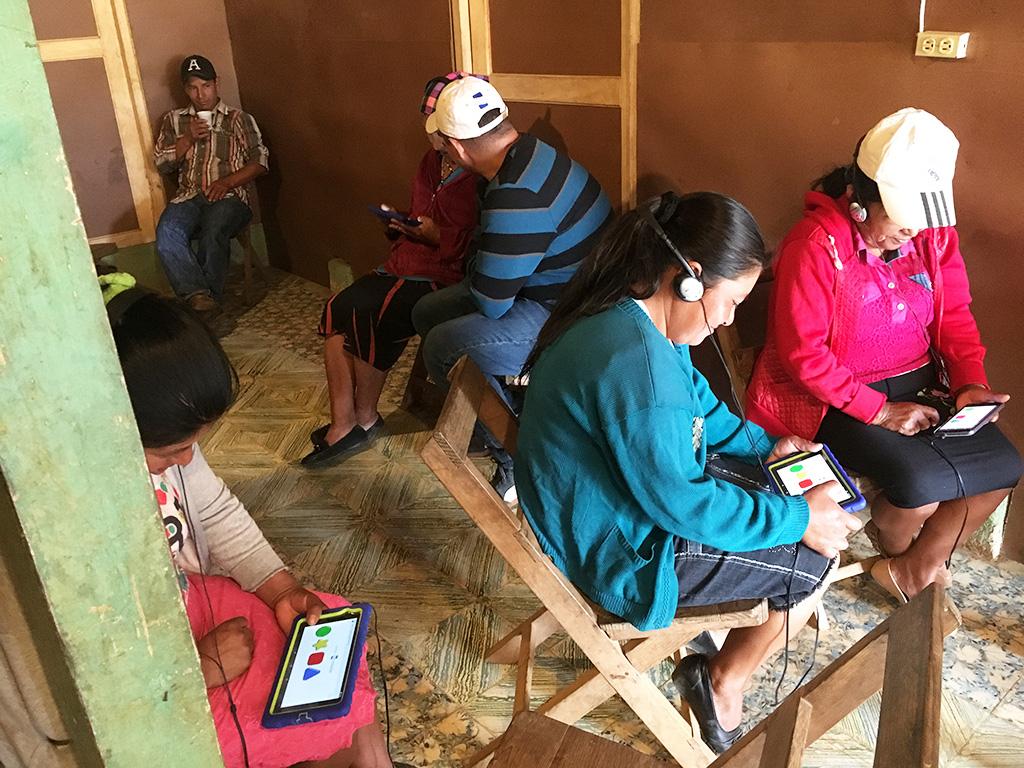 Community members in Honduras take the Restore Survey