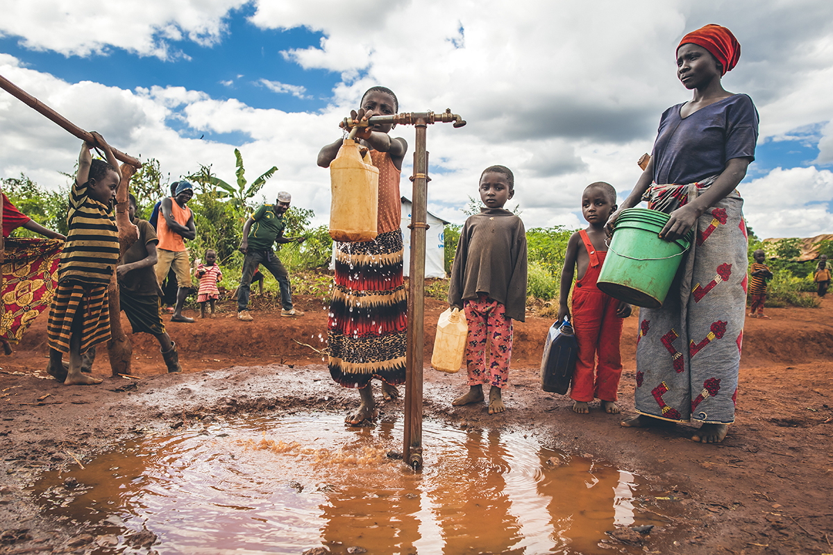 Children draw safe water in Nyarugusu