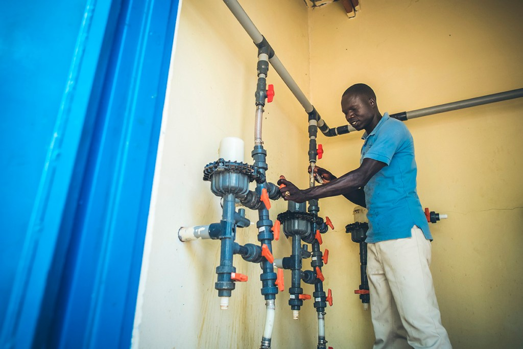 Water Mission Uganda technician making repairs to a water system.