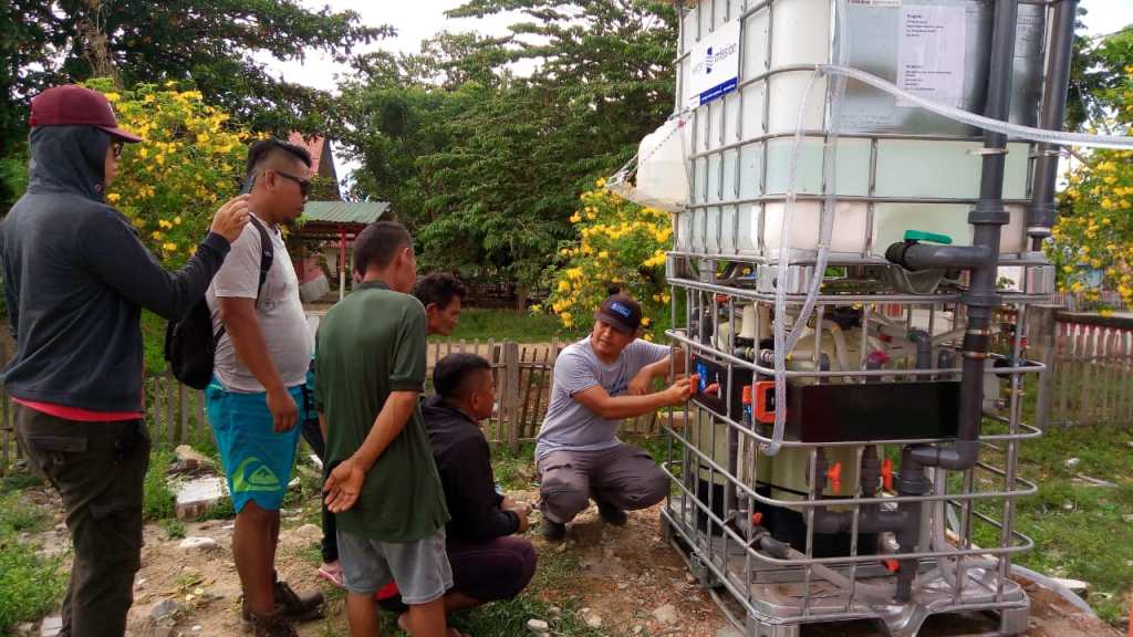 Water treatment system installation in Pombewe, Indonesia