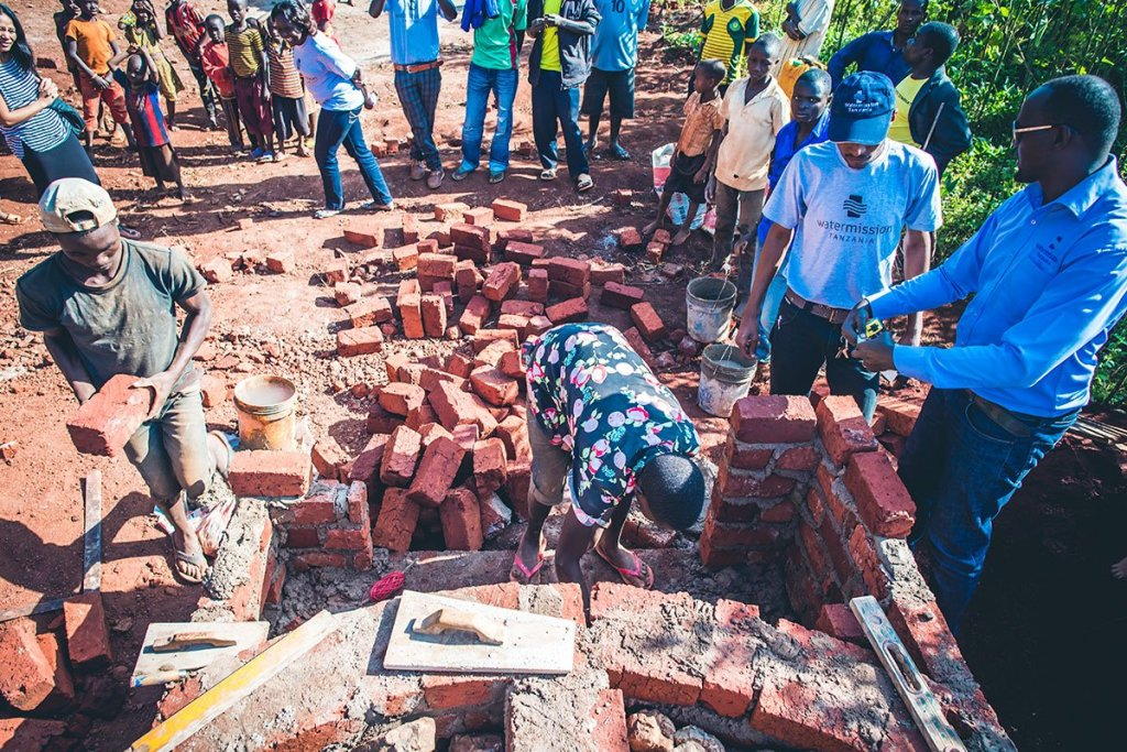 Residents of Zeze helping to construct a safe water system