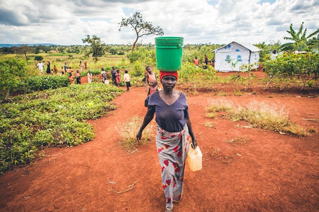 Walking for water in Nyarugusu Refugee Settlement
