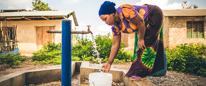 Rachel draws safe water from Mkinga's tap