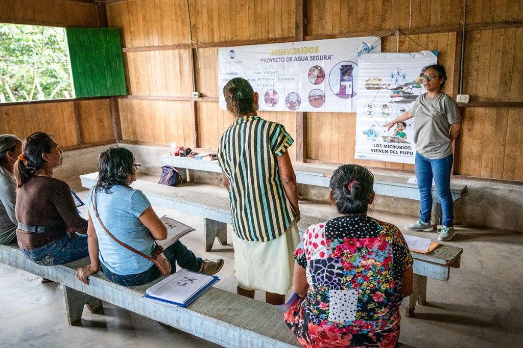 Leydi (right, standing) of Water Mission's Peru team trains a group of women as community WASH promoters!