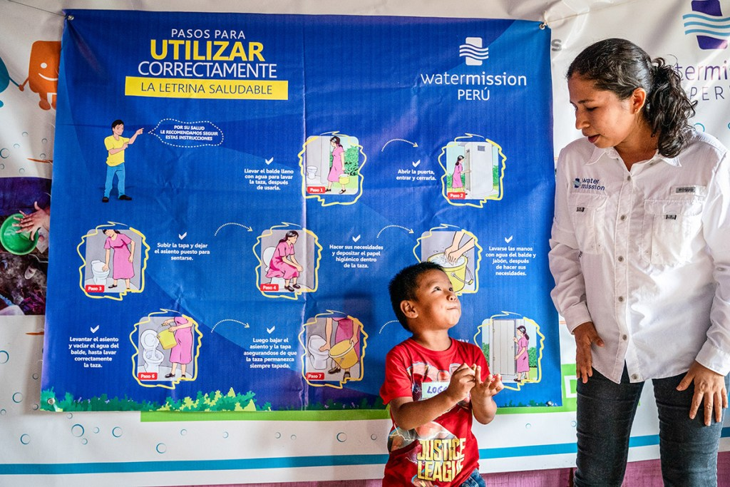 Vicky teaches healthy water, sanitation, and hygiene behaviors