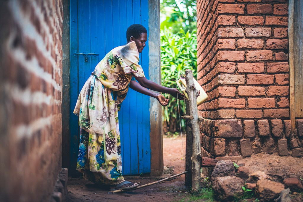 Alice using a Tippy Tap — one of Water Mission's healthy handwashing solutions