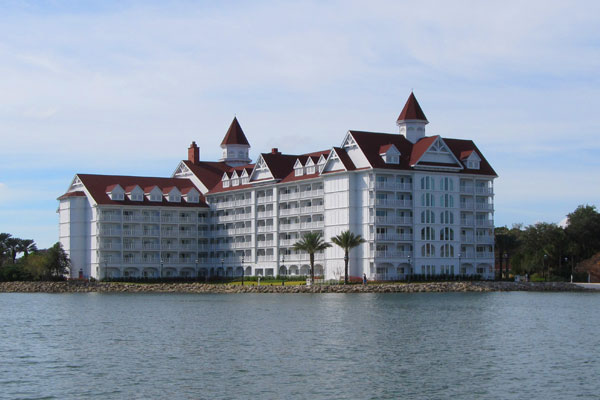 View of a large building for accommodations at the Disney Grand Floridian from the lake on a boat